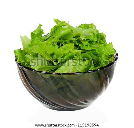 Fresh green lettuce leaves in a plate isolated on white background