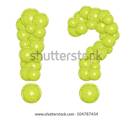 fresh green lime slices formed question and exclamation mark. - stock photo