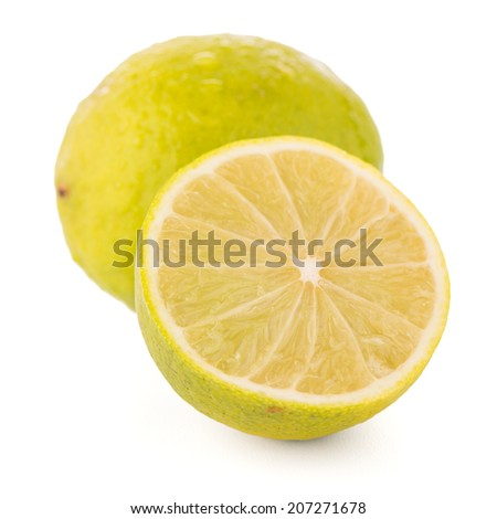 Fresh green limes isolated on white background.