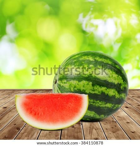 Fresh green melon on wooden desk. - stock photo