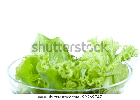 Fresh green organic vegetable salad in glass bowl isolated on white background