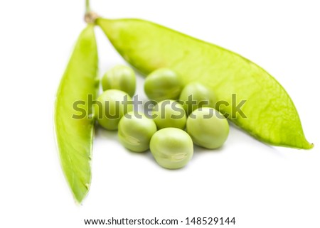 Fresh green pea pod and peas on white background. Macro shot with shallow depth of field. Selective focus.