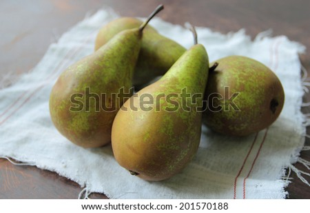 Fresh green pears on a kitchen table