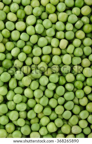 Fresh green peas for background uses - stock photo