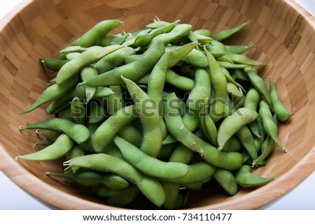 Fresh green peas in the  wood bowl