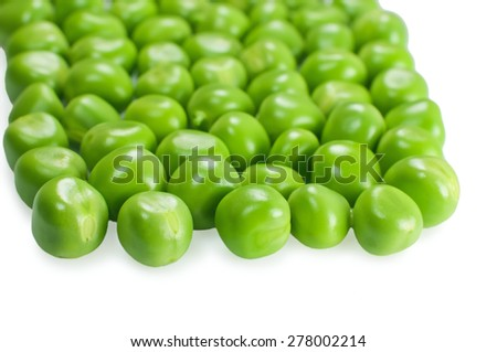 Fresh green peas on white - stock photo