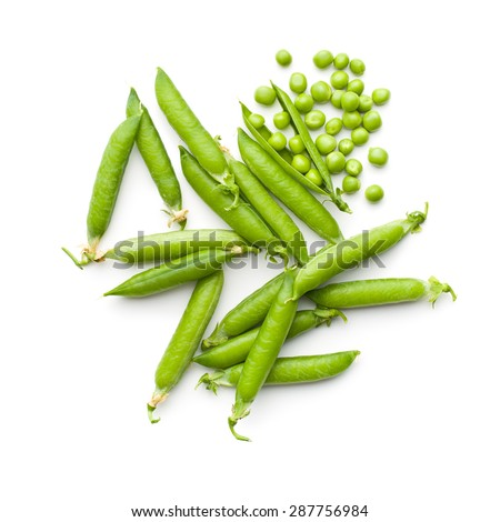 fresh green peas on white background - stock photo