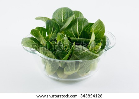Fresh green raw Pak Choi (Chinese Cabbage) isolated on white background
