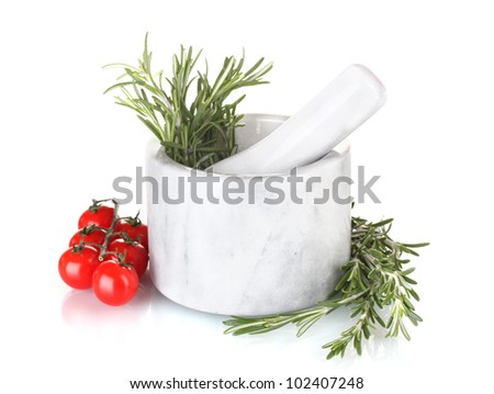 fresh green rosemary in mortar and tomatoes cherry isolated on white