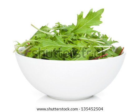 Fresh green salad in a bowl. Isolated on white background - stock photo