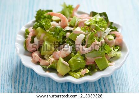 Fresh green salad with shrimp and avocado - stock photo
