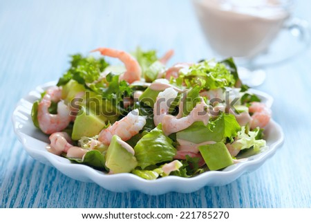 Fresh green salad with shrimp and avocado - stock photo