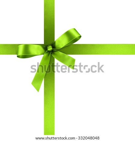 Fresh Green Satin Gift Ribbon with Decorative Bow - Ornate Textile Decor - Isolated on White Background - For Christmas and Easter Season - Valentine and Mothers Day - stock photo