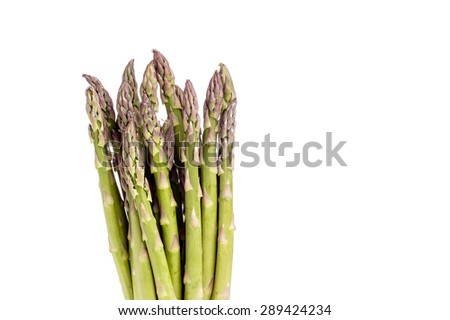 Fresh green spring asparagus, isolated on white with copy space - stock photo