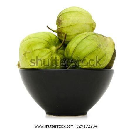 fresh green tomatoes on bowl - stock photo