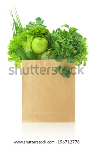 Fresh green vegetables and fruits in a paper grocery bag - stock photo