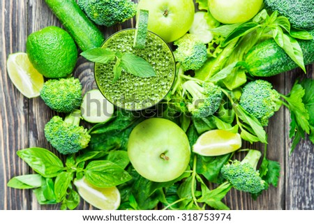Fresh green vegetables and green smoothie with spinach in glass. Detox, diet or healthy food concept  - stock photo