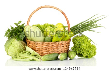 fresh green vegetables in basket isolated on white - stock photo