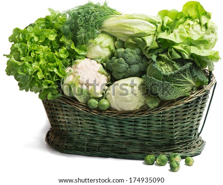 Fresh green vegetables in  wicker basket isolated on white  - stock photo