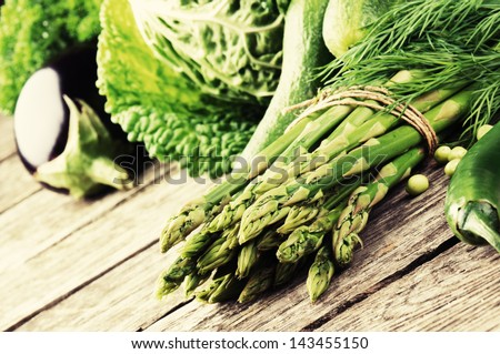 Fresh green vegetables on wooden table - stock photo