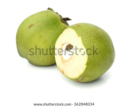 Fresh green young coconut split in half showing white flesh, isolated on white background - stock photo