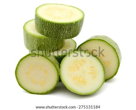 fresh green zucchini slices on white background  - stock photo