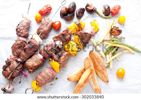 fresh grilled beef with vegetable shish kabobs - stock photo