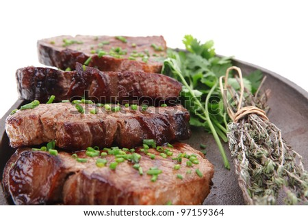 fresh grilled red meat with thyme on metal pan isolated on white background - stock photo