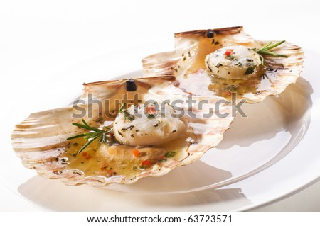 Fresh grilled scallops on white plate close up - stock photo