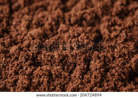 fresh ground coffee background, close up photo