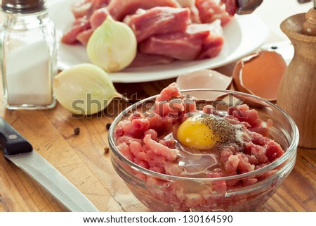 fresh ground meat cooked with egg and onion - stock photo