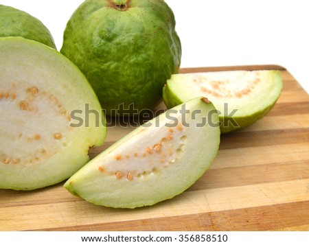 Fresh guava fruit on wooden board on white background.