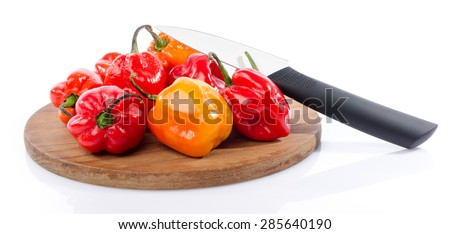 Fresh habanero peppers on cutting board, isolated on white