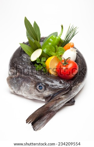 Fresh hake with vegetables - stock photo