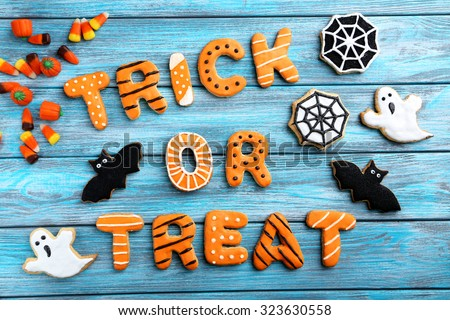 Fresh halloween gingerbread cookies on blue wooden table - stock photo