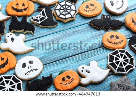 fresh halloween gingerbread cookies on blue wooden table - Halloween Gingerbread Cookies