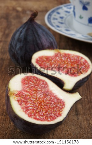Fresh halved whole fig showing the seeds