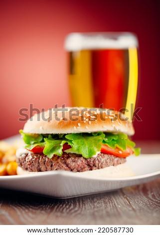 Fresh Hamburger With Beer - stock photo