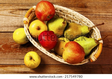 Fresh harvest of apples and pears.  - stock photo