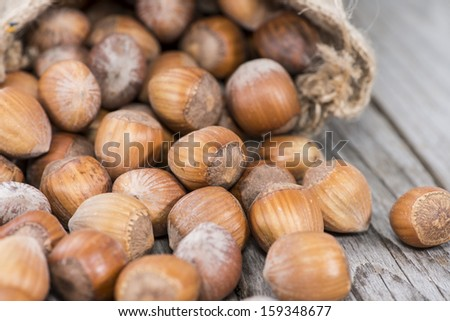 Fresh hazelnuts on vintage wooden background