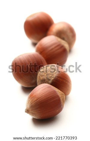 Fresh hazelnuts on white background