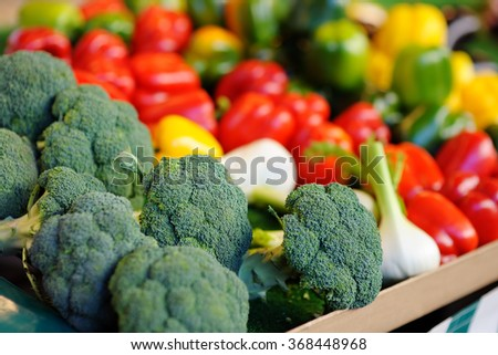 Fresh healthy bio broccoli and red paprika on Paris farmer agricultural market  - stock photo