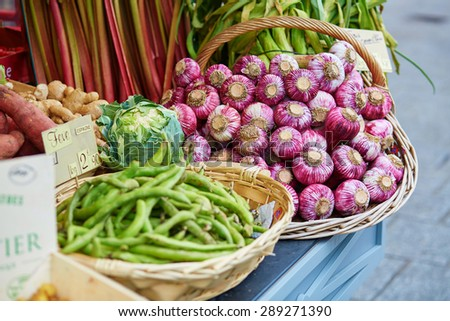Fresh healthy bio vegetables, garlic and green beans, on Parisian farmer agricultural market - stock photo