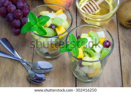 Fresh healthy fruit salad in a glass - stock photo