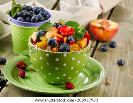 Fresh healthy fruit salad on a wooden table. Selective focus
