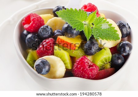 Fresh healthy fruit salad with mint leaves. Selective focus