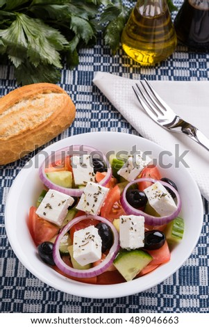 fresh healthy greek salad in white bowl