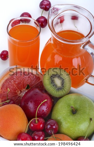 fresh healthy multivitamin juice of several fruits - stock photo