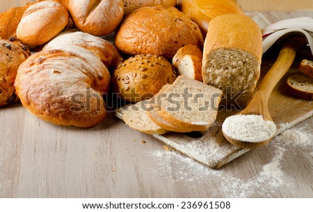 Fresh healthy natural bread on a wooden background. Selective focus - stock photo