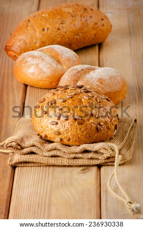 Fresh healthy natural bread on a  wooden board. Selective focus - stock photo
